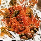Spaghetti with green olive and caper sauce baked in foil